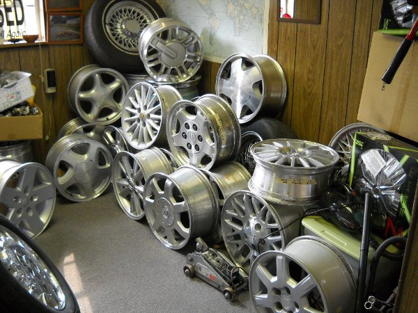 A collection of wheels and rims